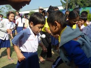 Children participating in games at International children day held 11.2.2014 in CDC high School
